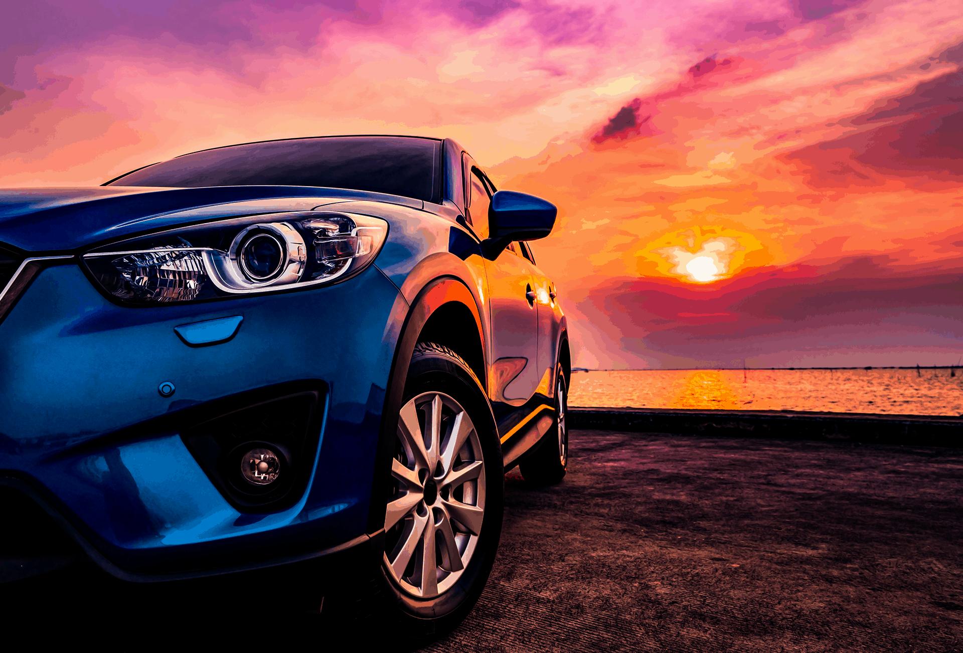 Blue vehicle at sun set