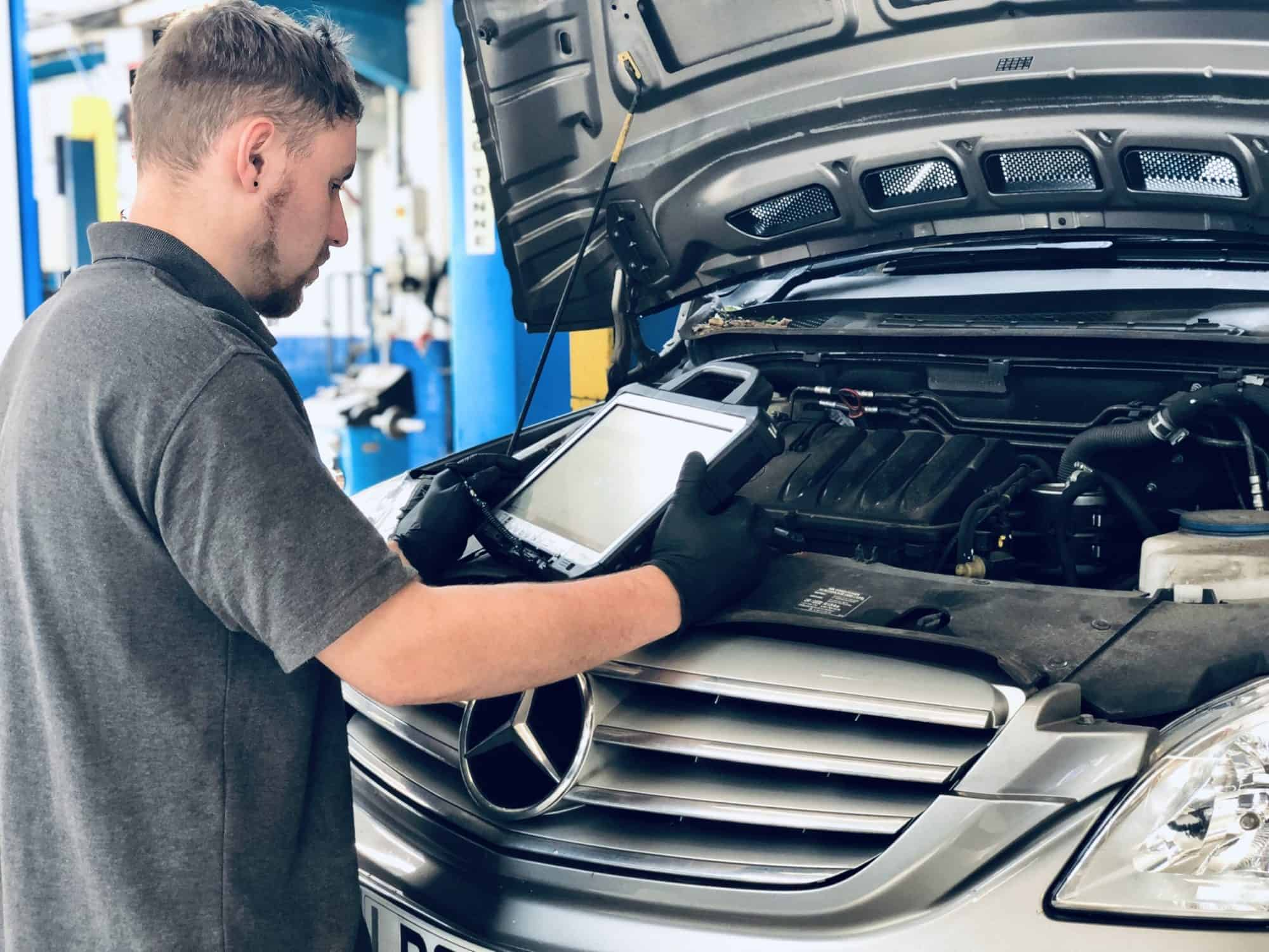 Our expert technician working on a Mercedes-Benz